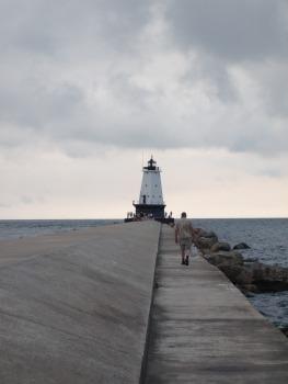man walking to lighthouse