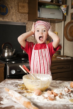 child attempting to bake, has hands on her head