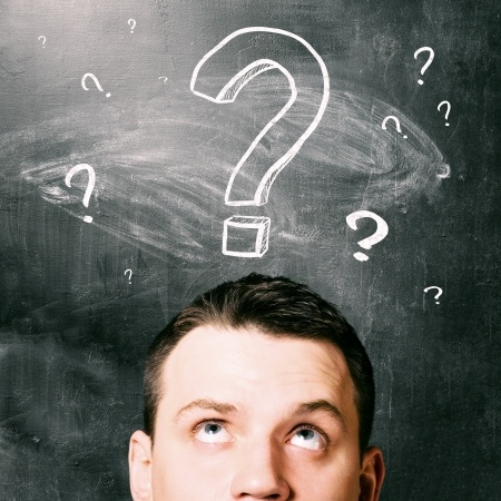 man with question marks above his head