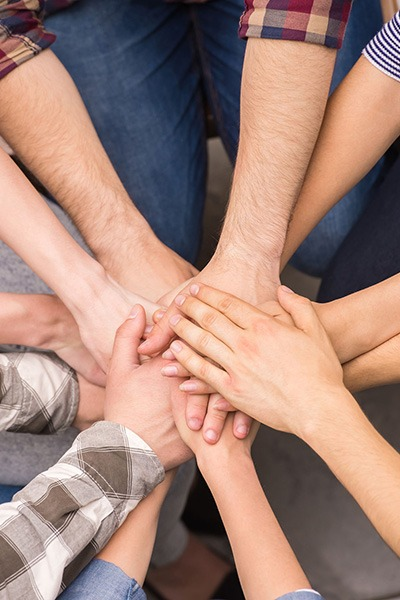All hands in the middle to show support