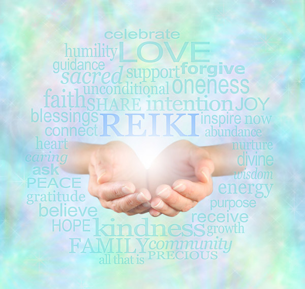 Hand holding light with words surround - Reiki